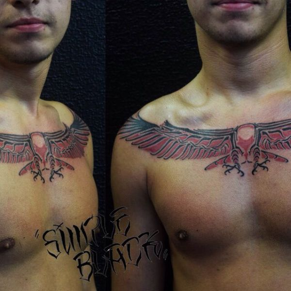 Татуировка узора хайда на груди парня