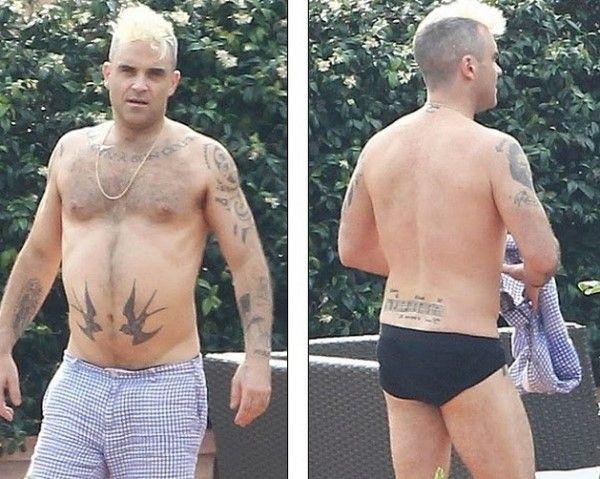 Робби Уильямс с татуировками на теле