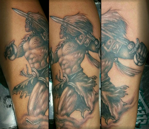Богатырь с мечом на ноге, тату