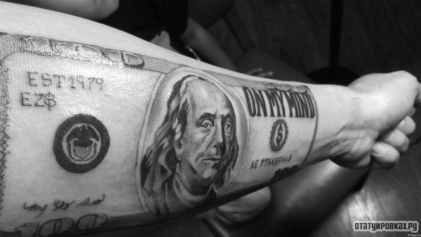 Татуировка доллар