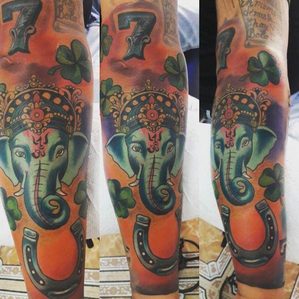 Татуировка, приносящая удачу хозяину в виде слоника ганеши