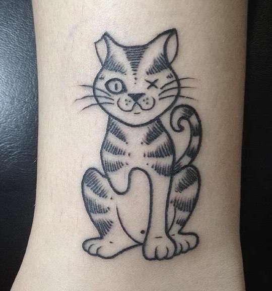 Полосатый кот без лапы и без глаза