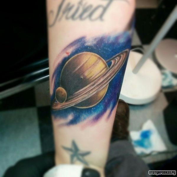 Татуировка сатурн