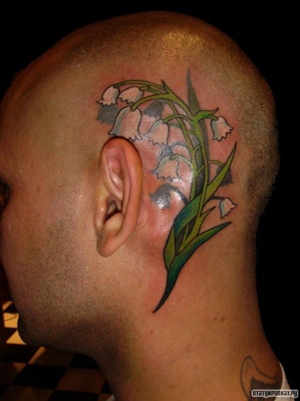 Татуировка ландыш на голове