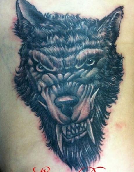 Тату оборотня в лице волка