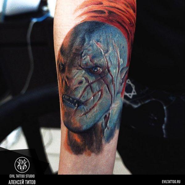 Татуировка зло в виде зеленого гоблина