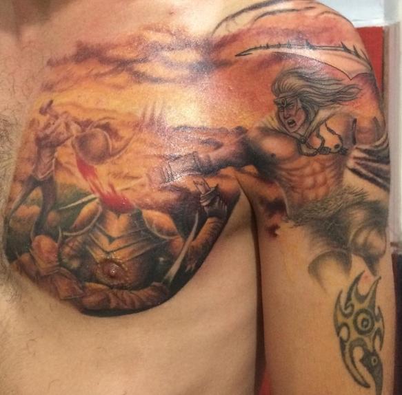 Татуировка богатыря в сражении, цветная тату