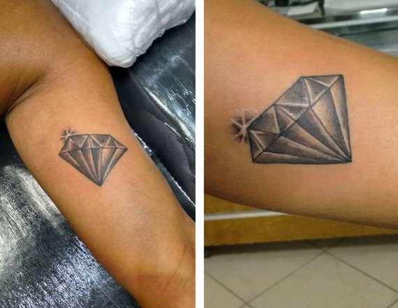Татуировка на руке в виде бриллианта с блеском