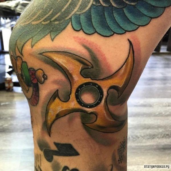 Татуировка сюрикен
