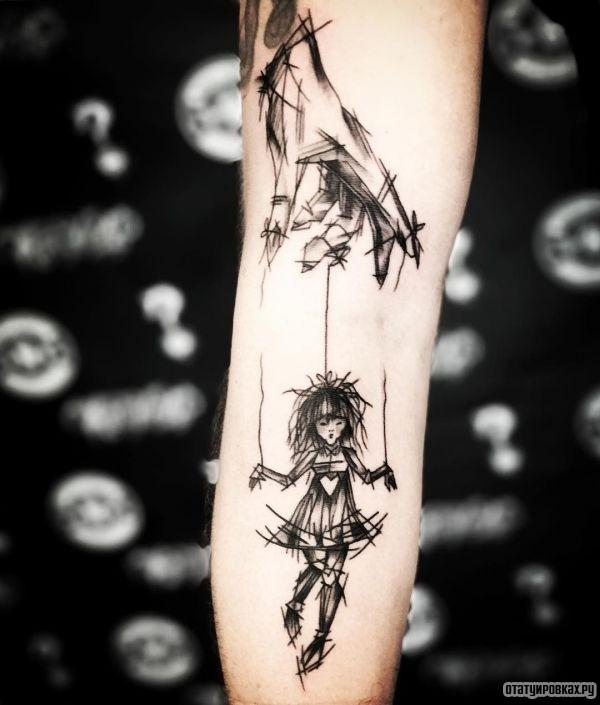 Татуировка марионетка
