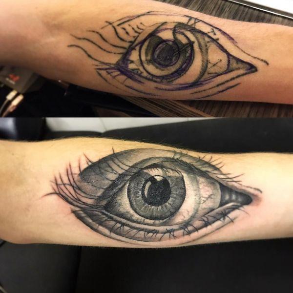 Перебитая татуировка большого глаза на руке