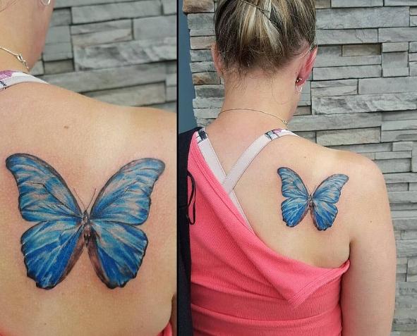 Татуировка на лопатке у девушки в виде бабочки - женственная