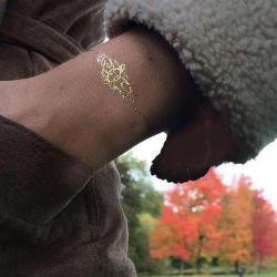 золотые татуировки фотография